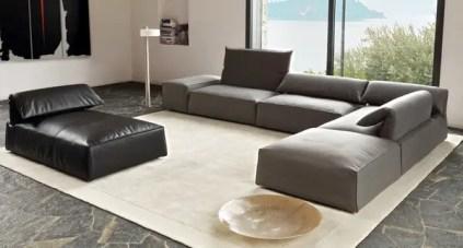 Modern-sectional-gray-sofa-natural-stone-floor-tile-sand-color-carpet