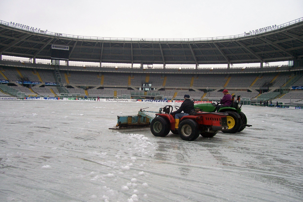 Removing snow from Matchsaver cover at Stadio Olimpico Turin