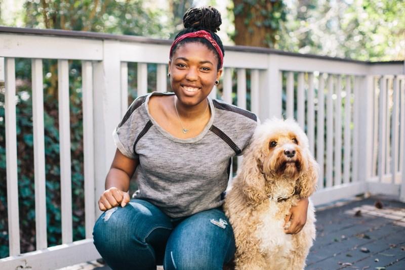Denene Millner's daughter Mari with their dog