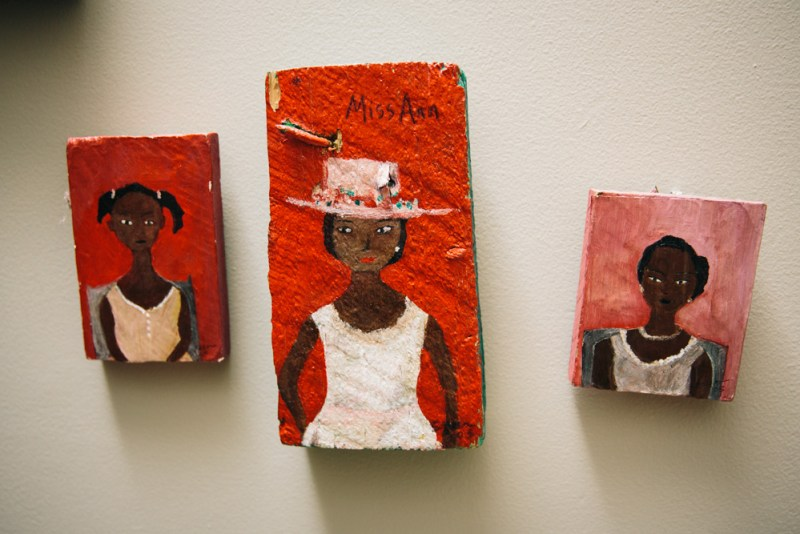 Three painted pictures of Black women and girls