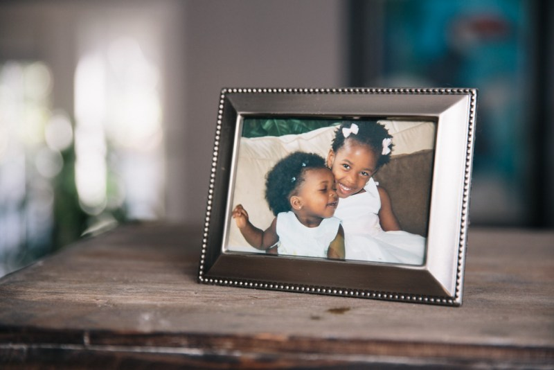 A framed photo of her daughters Lila and Mari
