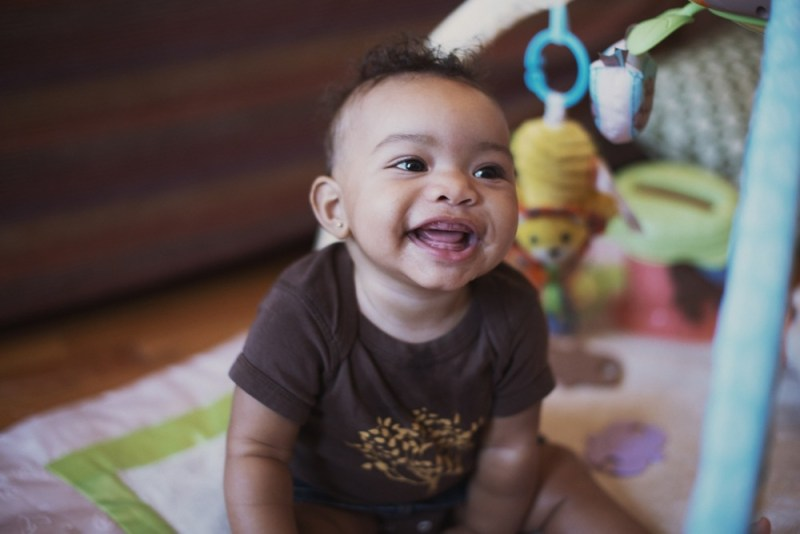 Baby smiling on activity mat