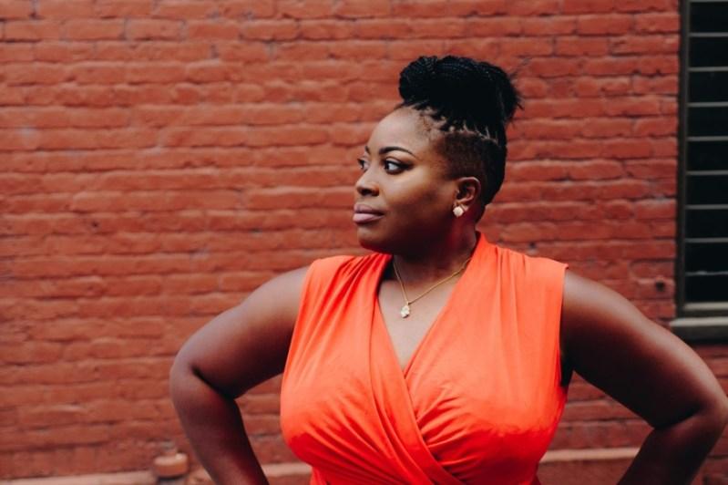 black woman in orange dress