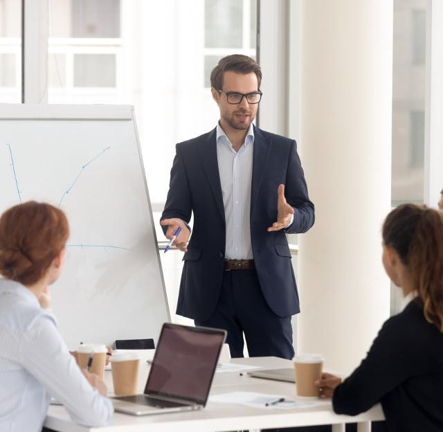 Executive talking to team members