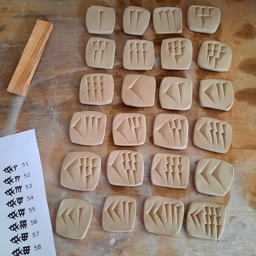 Garden babylonian clay tiles in process
