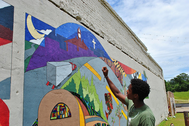 Jelani Moore contributed to a mural in Elba, Alabama during his Jean O'Connor-Snyder Internship. (Photo Credit: Auburn University, Flickr).