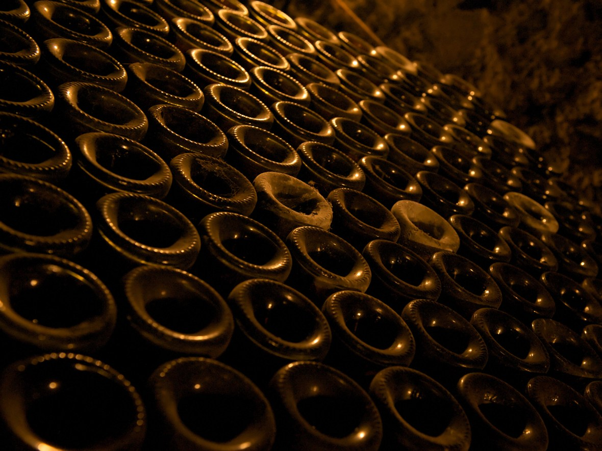 dusty bottles in the cellar of the Bouchard castle in Beaune, at the heart of Burgundy, France
