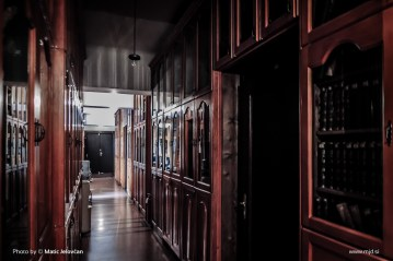 Hallways full of old books, enclosed in beautiful wooden cabinets