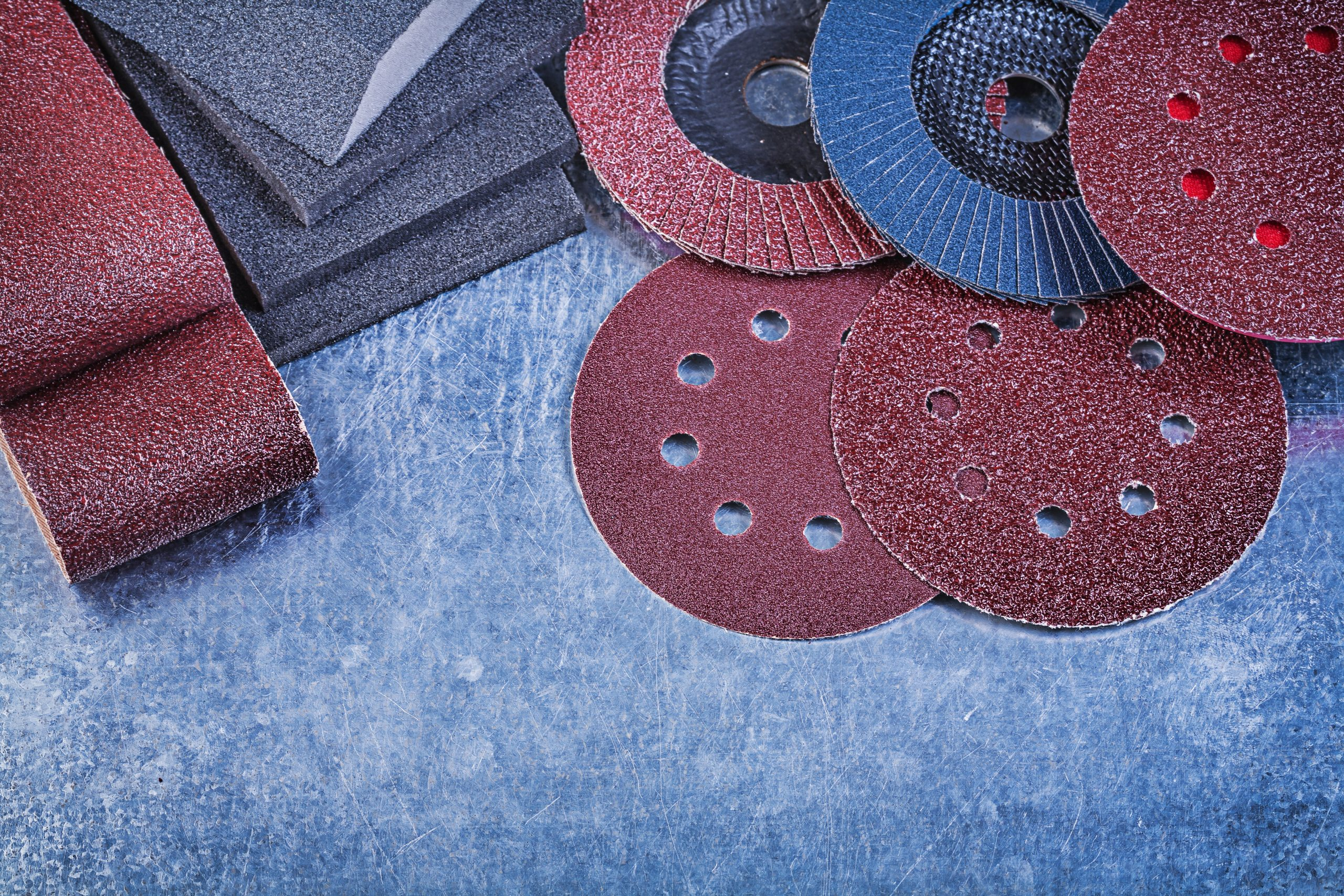 Composition of abrasive equipment on metallic background directl