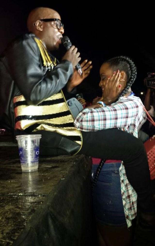 Former Miss Uganda Stellah Nantumbwe sizing up one of the Sauti Sol members.