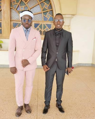 Sam Mukasa and his friend Kim Swagga.