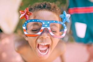 excited child with patriotic glasses on