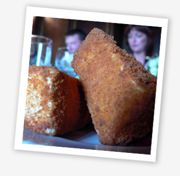 Deep fried Brie with redcurrant sauce