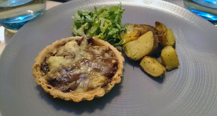 Caramelised onion and soft cheese tartlet