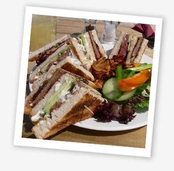 Kings Manor Steak Club Sandwich served on toasted Island bread with a horseradish, wholegrain mustard mayonnaise, leaves, tomatoes and onions