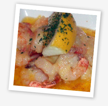 Tail-on king prawns with monkfish tail served in a garlic butter and cheese sauce