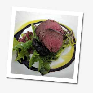 Pan-roasted Oslinc Farm ostrich fillet, Cognac marinated prunes and pecan salad with mosto cotto