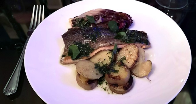 Pan-seared rainbow trout, served with radicchio, sautéed new potatoes and salsa verde