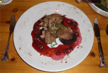 Pigeon breasts with black pudding, bacon and blackberry brandy sauce
