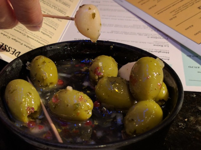 Marinated green olives and garlic cloves