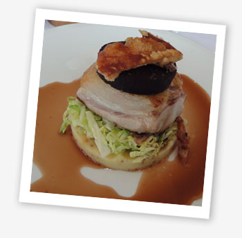 St Helens Restaurant slow-cooked belly of pork with grain mustard mash, cabbage, crackling and black pudding