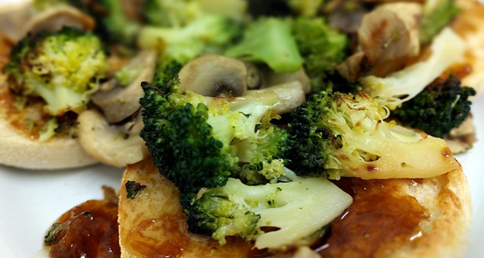 Broccoli and mushrooms on muffin
