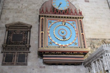 Ornate astronomical clock has the sun at the center.