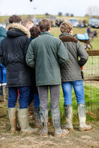 race goers studying form