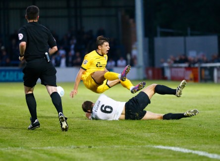 AUGUST 08: Dover Athletic v Bromley FC in Conference Premier at Crabble Stadium in Dover, England. Dover's defender Connor Essam slides into to foul Bromely's Brett Williams and gets a yellow card for his troubles. (Photo by Matt Bristow/mattbristow.net)