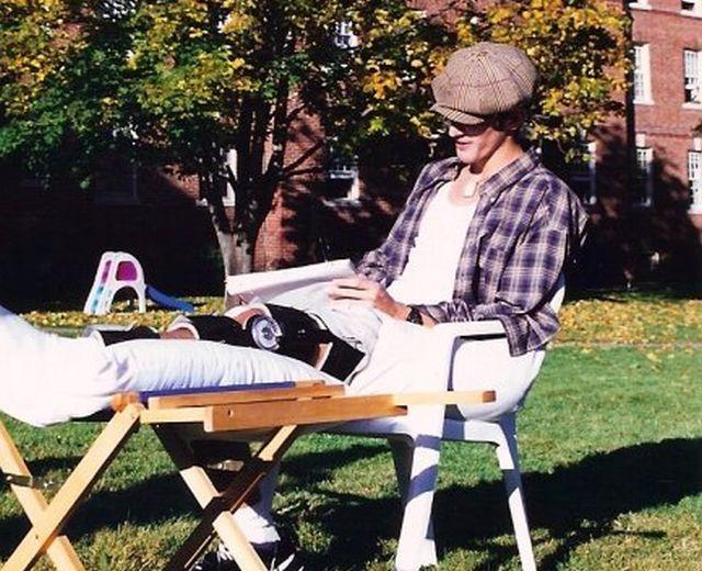 Mike Cavallo sitting outside Tilton Academy in knee brace post surgery