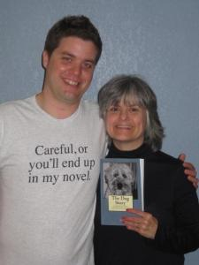 Matt Cavallo wearing his careful or you'll end up in my novel shirt posing with his mom, who got him the shirt because she ended up in the story.