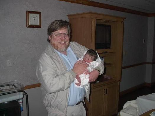 Grandpa holding Baby Alyson