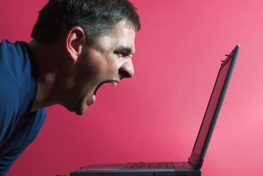 Blogger yelling into a computer