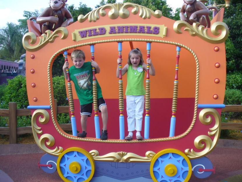 Kids posing as wild animals at Disney