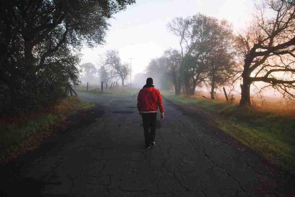 Red Jacket Man Walking on Road