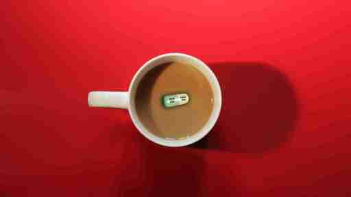 Picture of a cup of coffee with a Prozac pull in the middle.