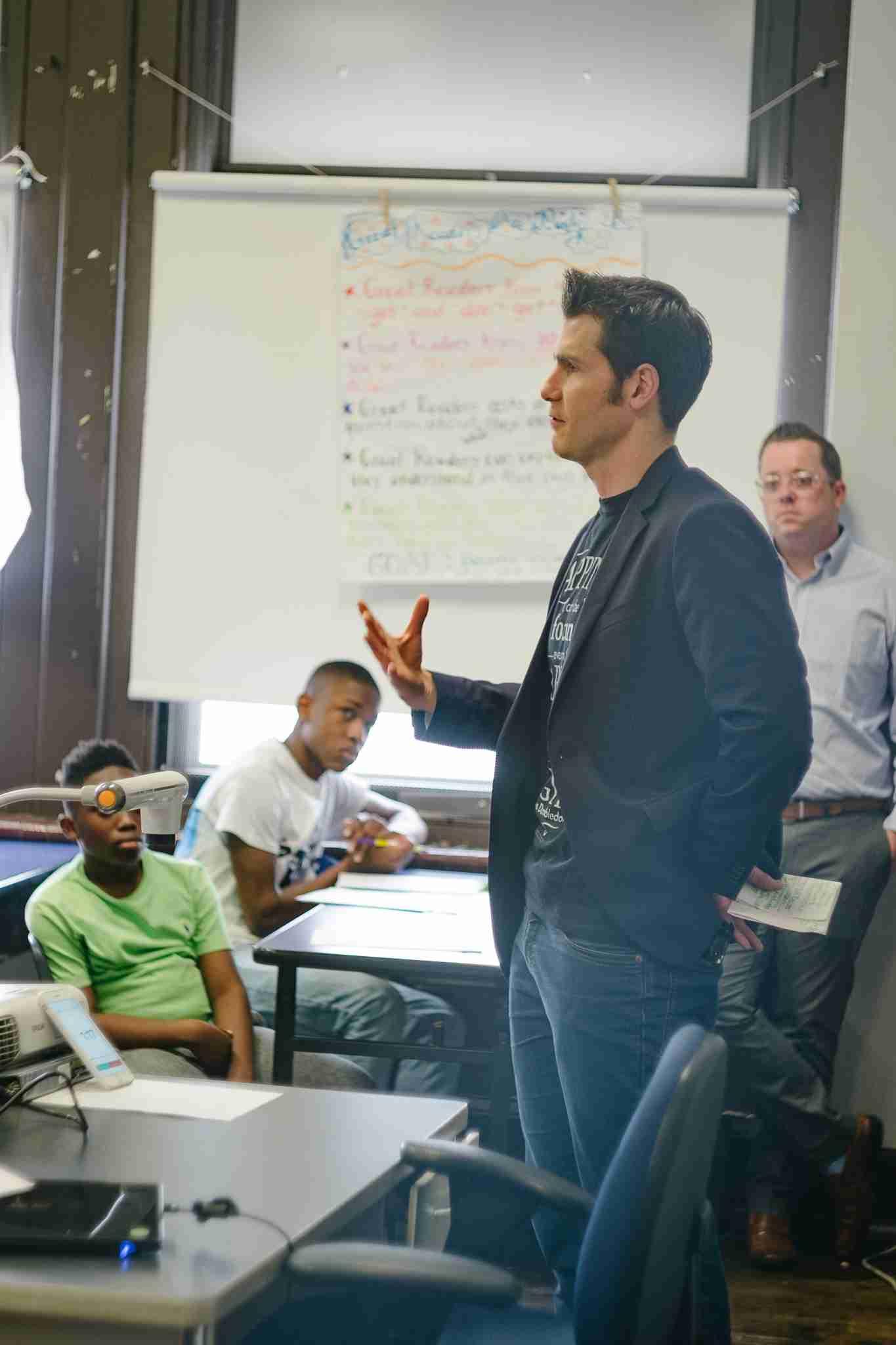 Matt talking to a class of kids