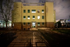 """Night-time view of an ex- Art School on the outskirts of Rome. For the past 6 years the building has been occupied by approximately 90 families and re-named """"Casale de Merode"""", from the same name as the road where it is situated. Rome, Italy 2009."""