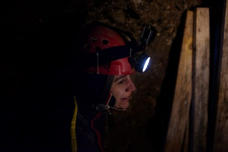 """Carol Laly Michel, a speleologist who works for the french team for research """"Nord Sud Institute"""", is seen before an immersion in a water flow discovered inside the Ravne tunnel. Visoko, Bosnia and Herzegovina, 2014. © Matteo Bastianelli for Discovery Communications"""