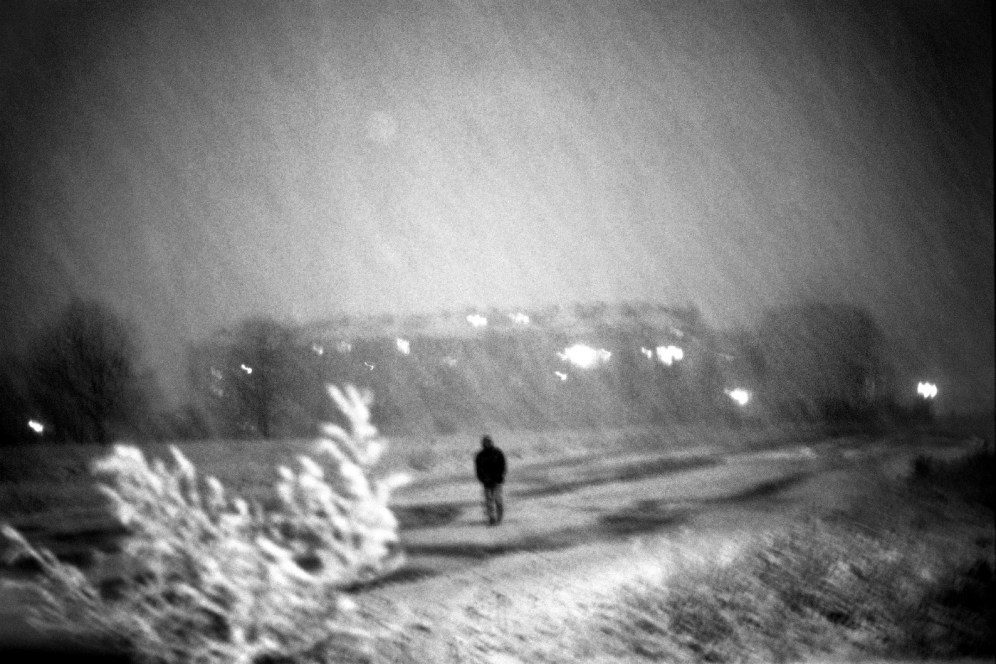 A man taking a walk in the city-centre during an autumn snowstorm. Sarajevo, Bosnia and Herzegovina, 2010. © Matteo Bastianelli
