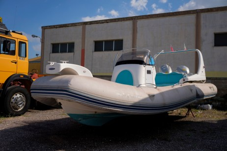 A vessel that was used for transporting weapons and drugs coming from Albania, and seized in Lecce on September 2015, is seen at an impound lot. Lecce, Italy 2016. © Matteo Bastianelli