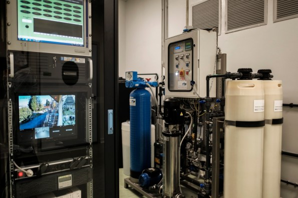 Water processing equipment for pharmaceutical use next to a video surveillance monitor at the Military Chemical-Pharmaceutical Plant in Florence, Italy 2016. © Matteo Bastianelli