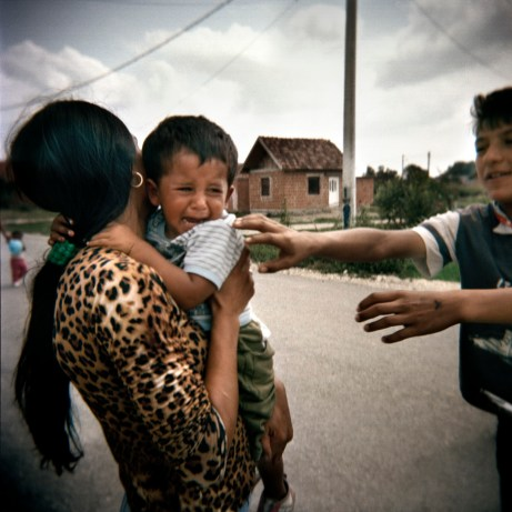 Some teenagers bother a child with his mother. Violence among youngsters is widespread inside the more isolated Rom communities. Podturen (Međimurje), Croatia 2009. © Matteo Bastianelli