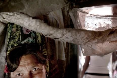 A woman inside her home. Podturen (Međimurje), Croatia 2009. © Matteo Bastianelli