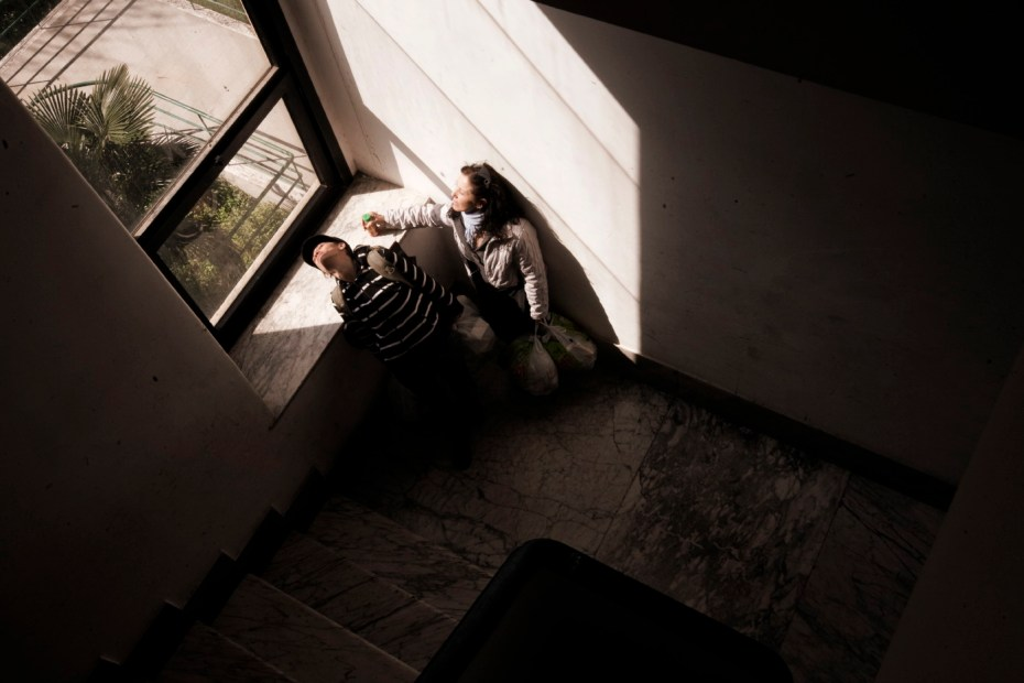 """Sonia and Nadia, aunt and niece, in the large hall at """"Casale de Merode"""". After the tragic end of both their marriages and the loss of their previous homes they were forced to squat so as not to become vagrants. Rome, Italy 2009. © Matteo Bastianelli"""