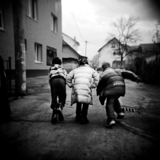 Three children play in the city centre. Gorazde, Bosnia and Herzegovina, 2010. © Matteo Bastianelli