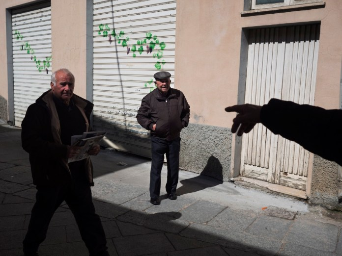 Some old men taking a walk in the streets of Villagrande. The village is the world-record holder for male longevity. Since the second post-war period until 2011, around 32 centenarians have been registered there. Villagrande Strisaili, Italy 2015. © Matteo Bastianelli