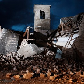 The ruins of a church destroyed after the earthquake swarm that hit central Italy. The bell tower was badly damaged, but endured the seismic tremors without collapsing. Visso, Italy 2016. © Matteo Bastianelli