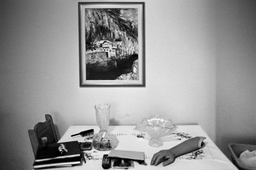 A false limb together with other objects on the sitting-room table in Adis Smajic's house. Sarajevo, Bosnia and Herzegovina, 2010. © Matteo Bastianelli