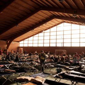 The evacuees of the town are seen sheltered in the municipal sport building turned into a temporary accommodation centre. Camerino, Italy 2016. © Matteo Bastianelli